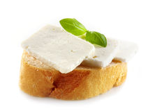 Bread with fresh goat cheese Stock Photos