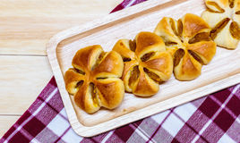 Bread. Fresh homemade pumpkin breads on wooden plate Stock Photo