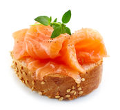 Bread with fresh salmon fillet Stock Images