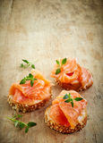 Bread with fresh salmon fillet Stock Photography