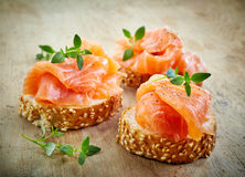 Bread with fresh salmon fillet Stock Image