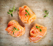 Bread with fresh salmon fillet Stock Photos