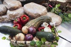 Bread, fresh vegetables, zucchini, garlic, bell pepper, onion, at the fair. Bread, fresh vegetables zucchini garlic bell pepper onion, at the fair in Spain royalty free stock image