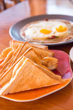 Bread and fried egg Stock Photos