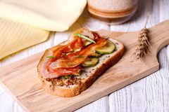 Bread with fried smoked bacon and fried zucchini Stock Image