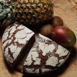 Bread and fruit. Wholemeal bread and selection of fruit Stock Images