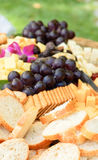 Bread, fruit and cheese platter Stock Photo