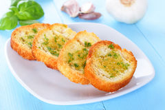 Bread with garlic. Fresh toasted bread with garlic and herbs royalty free stock images