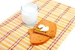 Bread, garlic and glass of milk Stock Photos