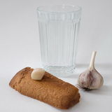 Bread with garlic. Garlic bread and a glass of water royalty free stock images