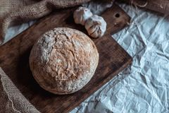 Bread with garlic on a brown wooden board 5 royalty free stock images