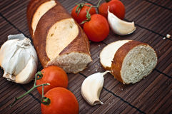 Bread, garlic and tomato Royalty Free Stock Photos