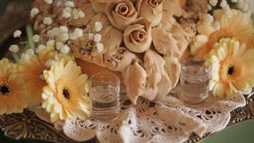 Bread with gerbera daisies in tray at wedding party. Panning shot of bread with gerbera daisies in tray at wedding party. Bread is decorated with flowers on stock footage