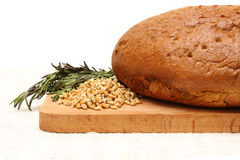 Bread, germinated wheat and rosemary. Breadб germinated wheat  and wooden board on a white linen tablecloths Stock Photography