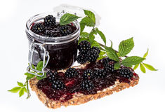 Bread and Glass with Blackberry Jam Royalty Free Stock Photography