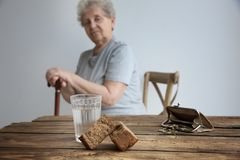 Bread, glass of water, purse and coins Stock Images