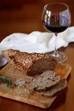 Bread and a glass of wine. On a wooden board and table Royalty Free Stock Photography