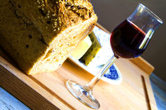 Bread, glass of wine and cheese Stock Photos