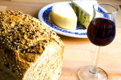 Bread, glass of wine and cheese Stock Photo