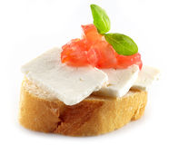 Bread with goat cheese. And chopped tomato Royalty Free Stock Photo