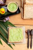 Bread with green custard and fresh milk. Royalty Free Stock Image