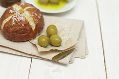 Bread and green olives - organic food Stock Images
