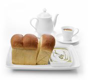 Bread and green tea on white background. Isolate Stock Photos