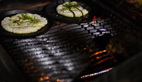 Grilled cake. Bread on the grill Stock Images