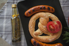 Bread and grilled sausages with greens Royalty Free Stock Photo