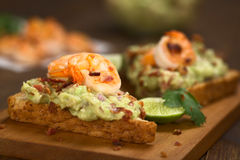 Bread with Guacamole, Shrimp and Bacon Royalty Free Stock Photos