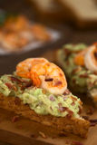 Bread with Guacamole, Shrimp and Bacon Royalty Free Stock Image