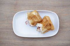 Bread ham cheese. On dish and wood background Stock Image
