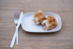 Bread ham cheese. On dish and wood background Royalty Free Stock Image