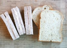Bread or ham and cheese sandwich. On wooden tray Stock Image