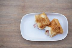 Bread ham cheese. On wood background Royalty Free Stock Image