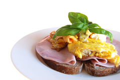 Bread with ham and eggs. Bread with fried eggs and ham royalty free stock photo