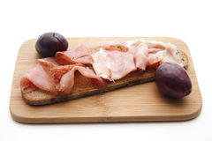 Bread with ham and plum Royalty Free Stock Photography