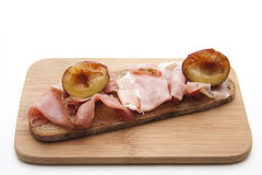 Bread with ham and plum Royalty Free Stock Image