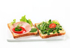 Bread with ham and salad greens Stock Photography