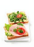 Bread with ham and salad greens Stock Images