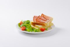 Bread with ham and vegetables Stock Photography