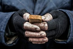 Bread in hand royalty free stock photography