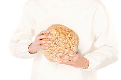 Bread in a hands of a baker Royalty Free Stock Photo