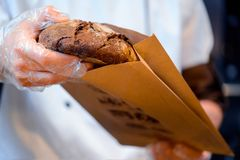 Bread in the hands of baker Royalty Free Stock Images