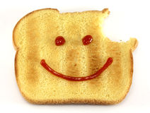 Bread with happy face and bite Royalty Free Stock Photography