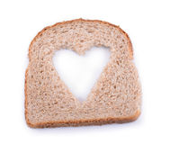 Bread heart. Brown bread slice with sybol of heart for heathly living Royalty Free Stock Photography