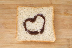 Bread and heart. Heart drawn in jam on sliced bread Stock Photos