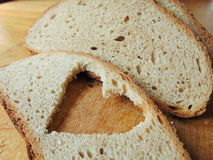 Bread with heart cut out of slice. In front royalty free stock photos