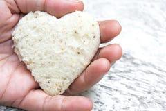 Bread heart in hand Stock Photo