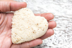 Bread heart in hand Royalty Free Stock Photos